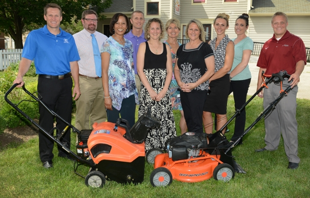 Cancer center volunteers help secure lawn equipment